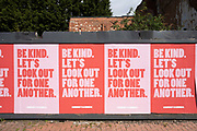 Local response to Coronavirus is felt on a street by street level as posters are pasted up on a hoarding promoting community kindness, reading: Be kind. Lets look out for one another on 6th April 2020 in Birmingham, England, United Kingdom. Coronavirus or Covid-19 is a new respiratory illness that has not previously been seen in humans. While much or Europe has been placed into lockdown, the UK government has announced more stringent rules as part of their long term strategy, and in particular social distancing.