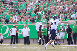 Oct 9, 2021; Huntington, West Virginia, USA; Marshall Thundering Herd safety Cory McCoy (2) intercepts a pass from Old Dominion Monarchs quarterback D.J. Mack Jr. (8) during the first quarter at Joan C. Edwards Stadium. Mandatory Credit: Ben Queen-USA TODAY Sports