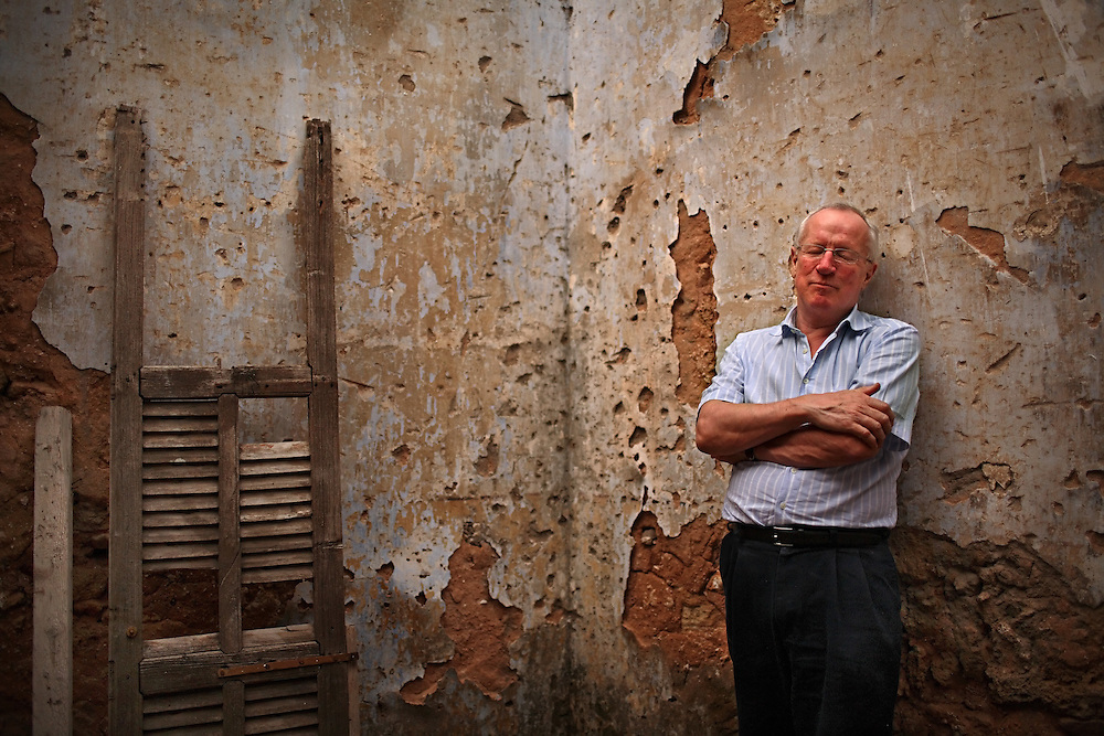 British journalist Robert Fisk poses for a portrait inside a building destroyed in Beirut's 15 year civil war in Beirut, Lebanon on March 25, 2008.The building was along the city's infamous Green Line. His new book is The Age of the Warrior: Selected Essays by Robert Fisk, a collection of his Saturday columns for the British newspaper The Independent.