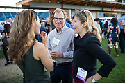 Chase Dearborn (center) talks with others during the Silicon Valley Business Journal 40 Under 40 event at Avaya Stadium in San Jose, California, on July 31, 2018. (Stan Olszewski for Silicon Valley Business Journal)