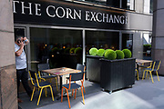 Street level decorative furniture and shrubs at the Corn Exchange pub, a bar in the City of London, the capital's financial district, on 8th June 2021, in London, England.