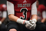 The Iraan High School football team remember Liz Pope with her name on their tape during the state championship game at AT&T Stadium in Arlington, Texas on December 15, 2016. (Cooper Neill for The New York Times)