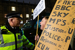 """A Leave campaigner shouts """"traitors"""" at police officers after a right wing Leave protester was arrested outside Parliament in London as MPs debate Prime Minister Theresa May's Brexit deal. London, January 15 2019."""