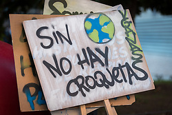 6 December 2019, Madrid, Spain: 'Sin planeta no hay croquetas' reads a sign, as thousands upon thousands of people prepare to march through the streets of central Madrid as part of a public contribution to the United Nations climate meeting COP25, urging decision-makers to take action for climate justice.
