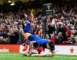 Josh Adams of Wales scores his sides first try<br /> <br /> Photographer Simon King/Replay Images<br /> <br /> Six Nations Round 1 - Wales v Italy - Saturday 1st February 2020 - Principality Stadium - Cardiff<br /> <br /> World Copyright © Replay Images . All rights reserved. info@replayimages.co.uk - http://replayimages.co.uk