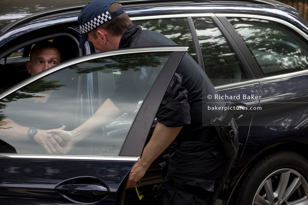 UK Met police officers outside the temporary perimeter fence encircling Winfield House, the official residence of the US Ambassador during the visit to the UK of US President, Donald Trump, on 12th July 2018, in Regent's Park, London, England.