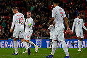 Wayne Rooney of England smiles back at his team mates during the International Friendly match between England and USA at Wembley Stadium, London, England on 15 November 2018.
