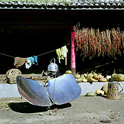 A solar kettle in use in the Miao/Hmong ethnic minority village in Le Li village, Yunnan Province, China