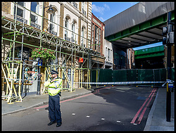 June 7, 2017 - London, London, United Kingdom - Image ©Licensed to i-Images Picture Agency. 07/06/2017. London, United Kingdom. London Bridge Terror Attack - Day 5...A police officer stands guard at the entrance to Borough Market in London. Much of the surrounding area has been reopened to public after the terror attacks that took place on Saturday the 3rd of June 2017. Seven people lost their lives and 48 were injured during the attacks on London Bridge and Borough Market...Picture by Pete Maclaine / i-Images (Credit Image: © Pete Maclaine/i-Images via ZUMA Press)