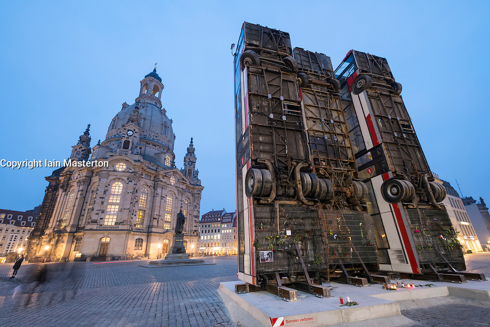 Sculpture of 3 vertical buses symbolising anti sniper barricade in Aleppo by Syrian-German artist Manaf Halbouni in Dresden, Germany.