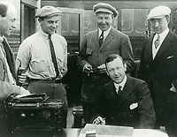 1913 CB DeMille (at left) and others watch as Jesse Lasky signs formation papers for the Jesse Lasky Feature Play Co.