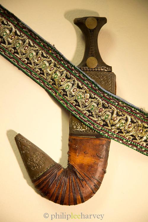 Decor at Al Tawasol restaurant. A traditional dagger or khanjar, United Arab Emirates