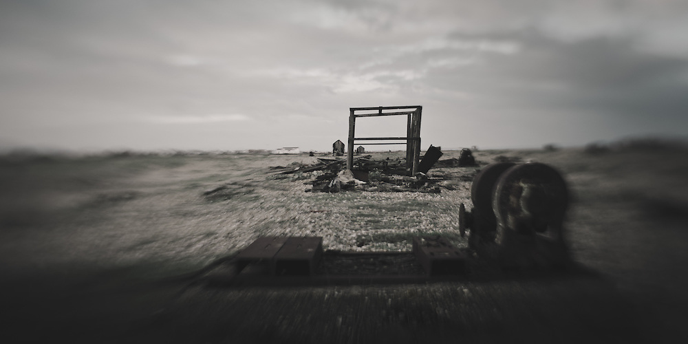 Abandoned industrial structures, beach, Dungeness, UK