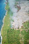 Kilauea volcano lava flow burning homes, Kalapana, Island of Hawaii