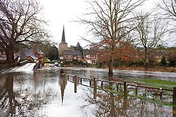 ©Licensed to London News Pictures 21/12/2019. <br /> Eynsford ,UK. The River Darent in Eynsford, Kent has burst its banks overnight due to the continued heavy rain. The Riverside road is closed at one end near the ford bridge. Photo credit: Grant Falvey/LNP