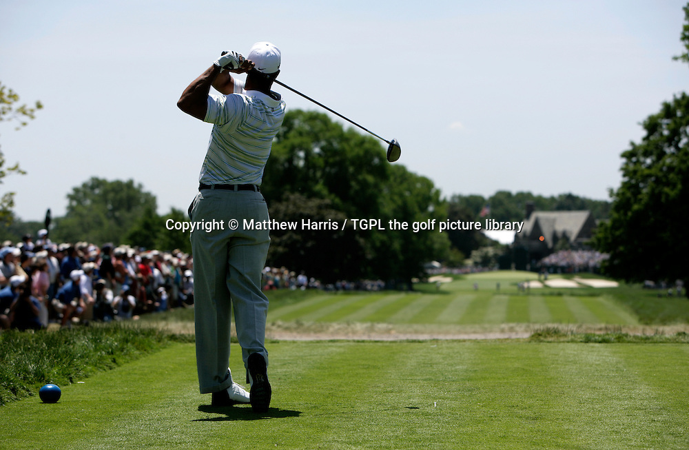 Tiger WOODS (USA) drives off 18th on his way to missing the cut for the first time as a pro;loosing his father and mentor Earl only shortly before certainly had a bearing on this happening,during second round US Open 2006,Winged Foot,New York,USA.