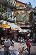 Activity and old building facades along Ngo Gach street, Hanoi, Vietnam, Southeast Asia