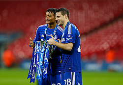 Juan Cuadrado and Cesar Azpilicueta of Chelsea hold up the trophy as they celebrate after winning the Capital One Cup Final - Photo mandatory by-line: Rogan Thomson/JMP - 07966 386802 - 01/03/2015 - SPORT - FOOTBALL - London, England - Wembley Stadium - Chelsea v Tottenham Hotspur - Capital One Cup Final.