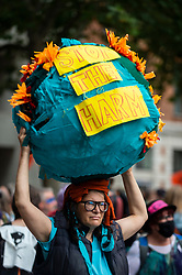"""© Licensed to London News Pictures. 03/09/2021. LONDON, UK.  A costumed climate activist from Extinction Rebellion with a sign ahead of a protest march from St Paul's Cathedral to the Lloyds Building in the City of London to highlight the complicity of the financial industry on climate change.  The event takes place on day twelve of the two week 'Impossible Rebellion' protest to """"target the root cause of the climate and ecological crisis"""".  Photo credit: Stephen Chung/LNP"""