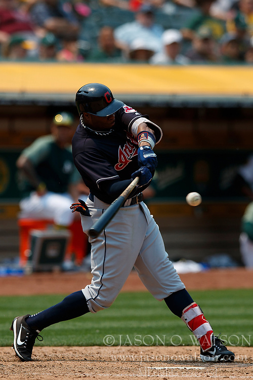 OAKLAND, CA - JULY 01: Rajai Davis #26 of the Cleveland Indians at bat against the Oakland Athletics during the sixth inning at the Oakland Coliseum on July 1, 2018 in Oakland, California. The Cleveland Indians defeated the Oakland Athletics 15-3. (Photo by Jason O. Watson/Getty Images) *** Local Caption *** Rajai Davis
