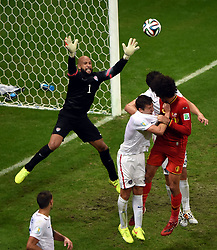 July 1, 2014 - Salvador, Brazil - Goalkeeper of the U.S. TIM HOWARD (L, up) attempts to block a shot during a Round of 16 match between Belgium and the U.S. of 2014 FIFA World Cup at the Arena Fonte Nova Stadium.  Belgium won 2-1 in extra time. Howard made 16 saves, the most on record in a World Cup match. (Credit Image: © Xinhua via ZUMA Wire)