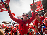 20 NOVEMBER 2013 - BANGKOK, THAILAND:  Thai Red Shirt supporters react to the Constitutional Court verdict that allows the government to stay in power. Thousands of Red Shirts, supporters of the Pheu Thai ruling party in Thailand, gathered in Rajamangala Stadium in suburban Bangkok to listen to the Thai Constitutional Court deliver its verdict against the government. The court ruled that the recent efforts by the government to pass a blanket amnesty bill violated the Thai Constitution but the court did not order the party to disband or the dissolution of the government, which had been widely feared.    PHOTO BY JACK KURTZ