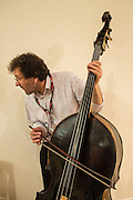 Zoran Markowi?, of ZMT, a Slovenian maker of tailpieces, plays a double-bass. Unlike traditional tailpieces, ZMT tailpieces have a longer distance from the bridge to the tailpiece for the bass strings.