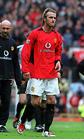 An upset looking David Beckham leaves the field after the match for possibly the last time at Old Trafford for Manchester United. Manchester United v Charlton Athletic, FA Premiership, 3/05/2003. Credit: Colorsport / Matthew Impey