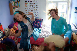 young girls messing around in the bedroom