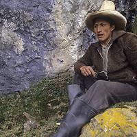 Maximilliano, a horseman from Unamen rests in Cordillera Central.