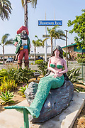 Pirate and Mermaid Concrete Paint Sculpture in Front of Rodeway Inn Hotel in Oceanside California