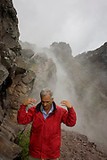 Giuseppe Mastrolorenzo, volcanologist with the Osservatorio Vesuviano and leading authority on local geology and civil evacuation plans, on the crater edge of the Vesuvius volcano, Italy.