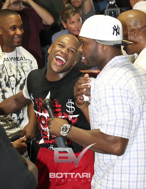 """LAS VEGAS, NV - APRIL 24:  Boxer Floyd Mayweather Jr. interacts with rapper Curtis """"50 Cent"""" Jackson as Floyd trains in front of the media at Mayweather Boxing Gym on April 24, 2012 in Las Vegas, Nevada.  (Photo by Jeff Bottari/Getty Images)"""