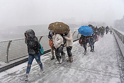 **2018 Pictures of the year by London News Pictures**<br /> © Licensed to London News Pictures. 27/02/2018. London, UK. Members of the public wade through heavy snowfall on the Millennium Bridge near St Paul's Cathedral in the City of London, as a cold front, named the 'Beast From the East' hits the capital. Amber weather warnings are in place for large parts of the east of the UK as a severe cold front heads in from Russia. Photo credit: Ben Cawthra/LNP