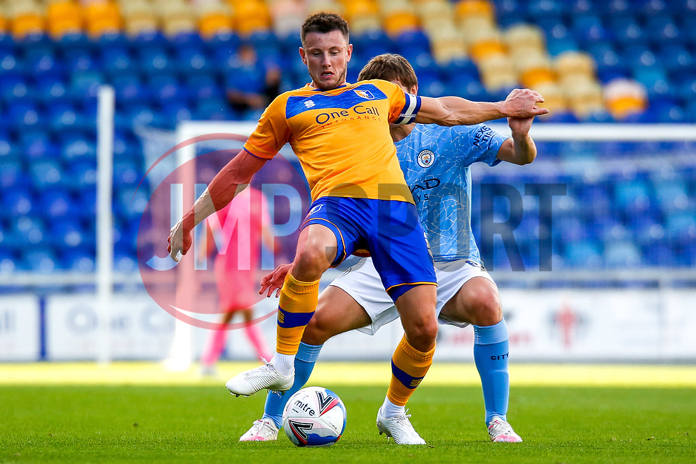 Ollie Clarke of Mansfield Town holds off pressure from Adrian Bernabe of Manchester City - Mandatory by-line: Ryan Crockett/JMP - 08/09/2020 - FOOTBALL - One Call Stadium - Mansfield, England - Mansfield Town v Manchester City U21 - Leasing.com Trophy