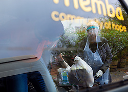 Volunteers pack food parcels into a bakkie, to be distributed to Vanwyk'svlei in Wellington, Western Cape, South Africa.(Picture: JULIAN GOLDSWAIN)