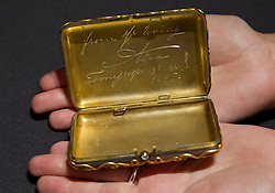 © Licensed to London News Pictures. 31/05/2013. London, UK. A Bonhams employee holds an inscribed jewelled Faberge cigarette case (c. 1897; est. GB£150,000-200,000), a gift from the Russian Empress Alexandra to Nicholas II - the last Tsar of the Russian Empire - on the occasion of the birth of their second daughter, at the press view for a sale of Russian art in London today (31/05/2013). The Russian sale, one of two held each year by Bonhams dedicated Russian Department  is set to take place on Wednesday the 5th of June.. Photo credit: Matt Cetti-Roberts/LNP