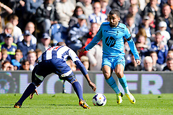 Aaron Lennon (ENG) of Tottenham Hotspur is challenged by Youssuf Mulumbu (COD) of West Brom - Photo mandatory by-line: Rogan Thomson/JMP - 07966 386802 - 12/04/2014 - SPORT - FOOTBALL - The Hawthorns Stadium - West Bromwich Albion v Tottenham Hotspur - Barclays Premier League.