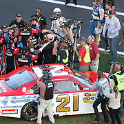 Crew members of Trevor Bayne driving the Motorcraft/Quick Lane Ford celebrate after winning the Daytona 500 Sprint Cup race at Daytona International Speedway on February 20, 2011 in Daytona Beach, Florida. (AP Photo/Alex Menendez)
