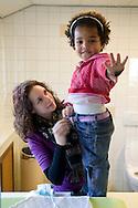 """Nederland, Herpen, 20090128...kleuter leidster verschoont een kind. ..Kinderopvang 'Op de boerderij' in Herpen...""""OP DE BOERDERIJ"""" kinderopvang..is gevestigd bij een vleesveebedrijf te Herpen.....Netherlands, Herpen, 20090128. ..kindergarten teacher changes diaper...Childcare on the farm in Herpen. ..""""ON THE FARM"""" childcare ..is located at a beef farm in Herpen."""