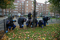 © Licensed to London News Pictures. 12/10/2020. London, UK. Police search team carry out a search in a children's playground within the crime scene in Homerton in Hackney, north London following a triple shooting. Officers were called at 22:48hrs on Sunday, 11 October, to reports of a shooting on Homerton High Road in Hackney, and found three people with gunshot injuries. Two men, aged 60 and 32, were taken to hospital with non life-threatening/life-changing injuries. A third man, aged 24, was taken to hospital and remainsin a life-threatening condition. Photo credit: Dinendra Haria/LNP