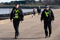 Edinburgh, Scotland, UK. 31 March, 2020. Police patrol public parks and walking areas to enforce the coronavirus lockdown regulations about being outdoor. Police patrol Marine Drive.  Iain Masterton/Alamy Live News
