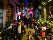 25 DECEMBER 2017 - HANOI, VIETNAM: Evening pedestrian traffic on Ngo Huyen Street in the Old Quarter of Hanoi.     PHOTO BY JACK KURTZ