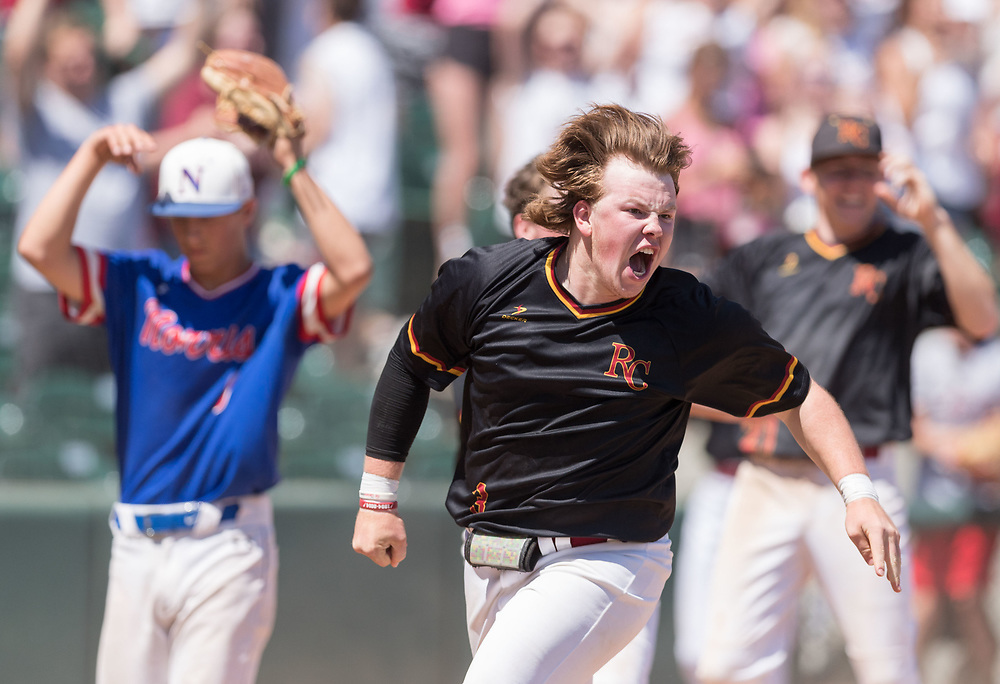 Roncalli's Thomas Alitz cheers after scoring the winning run on a hit by Logan McGill with two outs in the seventh inning. Roncalli defeated Norris 6-5 in the Class B baseball championship at Haymarket Park on Thursday, May 17, 2018, in Lincoln.<br /> <br /> MATT DIXON/THE WORLD-HERALD
