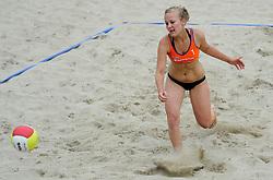 06-06-2010 VOLLEYBAL: JIBA GRAND SLAM BEACHVOLLEYBAL: AMSTERDAM<br /> In een koninklijke ambiance streden de nationale top, zowel de dames als de heren, om de eerste Grand Slam titel van het seizoen bij de Jiba Eredivisie Beach Volleyball - Inge van den Outenaar / Eveline Stevens<br /> ©2010-WWW.FOTOHOOGENDOORN.NL