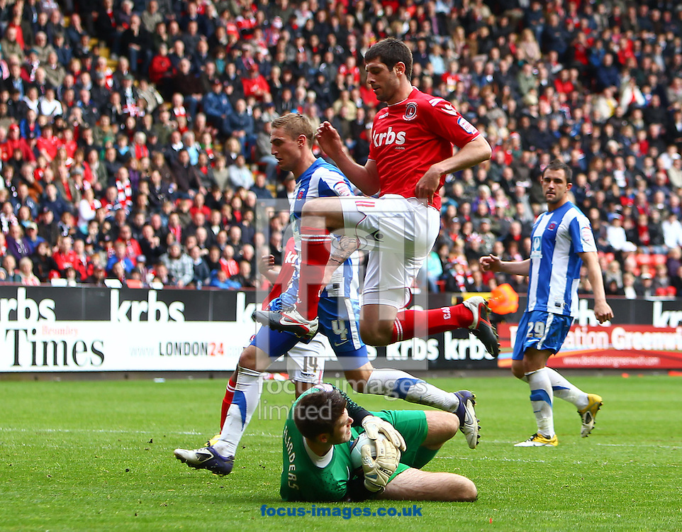 Picture by John Rainford/Focus Images Ltd. 07506 538356.05/05/12.Danny Hollands of Charlton Athletic and Scott Flinders of Hartlepool United during the Npower League 1 match at The Valley stadium, London.