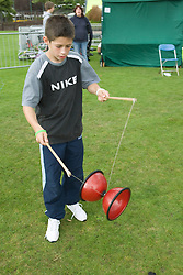 Boy juggling with a diabolo at a Parklife summer activities event,