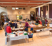 Shoppers browsing stalls at a Flea market inside the Corn Exchange building, Devizes, Wiltshire, England, UK