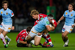 Perpignan Hooker (#2) Guilhem Guirado (capt) is tackled by Gloucester Inside Centre (#12) Ryan Mills and Fly-Half (#10) Billy Twelvetrees during the first half of the match - Photo mandatory by-line: Rogan Thomson/JMP - Tel: 07966 386802 - 12/10/2013 - SPORT - RUGBY UNION - Kingsholm Stadium, Gloucester - Gloucester Rugby v USA Perpignan - Heineken Cup Round 1.
