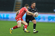 Rhys Webb of the Ospreys ® goes past Gareth Davies of the Scarlets. Guinness Pro12 rugby match, Ospreys v Scarlets at the Liberty Stadium in Swansea, South Wales on Saturday 26th March 2016.<br /> pic by  Andrew Orchard, Andrew Orchard sports photography.